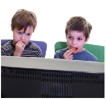 Kids eating junk food in front of TV