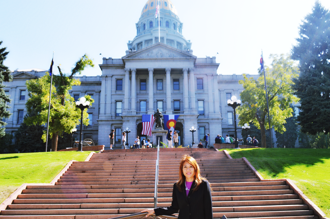 Fiona in front of the Colorado Capitol